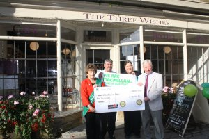 From L to R Dorset County Chair for Macmillan  Christine Bueno,  Paul King  Owner of The Three Wishes , Claire Coles Area Manager  for Macmillan, and Michael Rawlinson  from  Sherborne Rotary