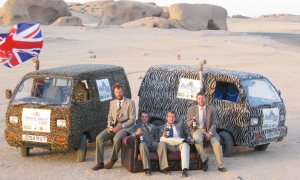 Great Balls of Fur team enjoying their Badger First Gold in the Algerian desert